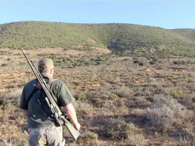African Hunting - Hunter walking in veld.