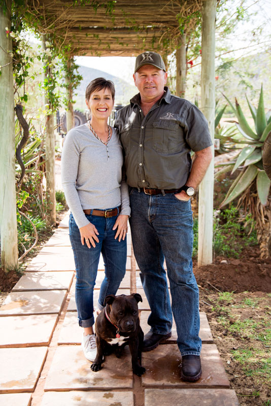 African Hunting - Owners of the Hunting Lodge - Rob & Laura Birch, with their dog Barron standing in front of the lodge.